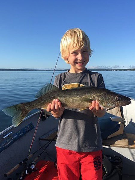 Young angler with walleye